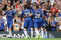 Chelsea players congratulate Tammy Abraham after scoring their opening goal during Chelsea vs Sheffield United, Premier League Football at Stamford Bridge on 31st August 2019