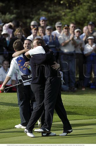 THOMAS BJORN (Europe) is congratulated by Darren Clarke after his singles win against Cink, The 34th Ryder Cup 2002, The Belfry, Sutton Coldfield, 020929. Photo: Glyn Kirk/Action Plus....golf.celebrate celebrates celebration celebrations joy.....