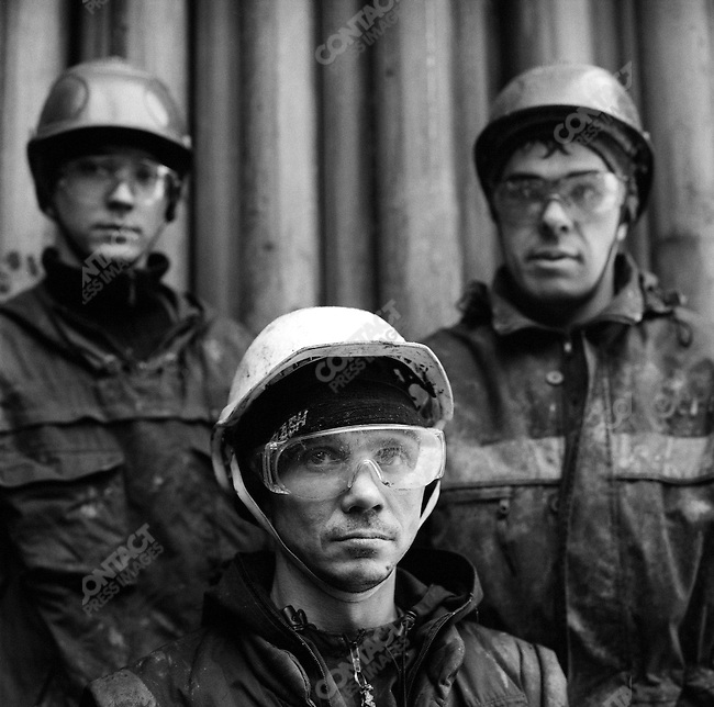 Workers from the Siberian Geosphysical Company, part of the Schlumberger, the oil industry giant, stood in the heavy winter conditions on the derrick at a site in the Nefteyugansk field where they are boring wells for Rosneft. Siberia, Russia, November 20, 2007