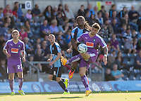 Marcus Bean of Wycombe Wanderers and Graham Carey of Plymouth Argyle battle for the ball during the Sky Bet League 2 match between Wycombe Wanderers and Plymouth Argyle at Adams Park, High Wycombe, England on 12 September 2015. Photo by Andy Rowland.