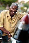 African American with his classic Cadillac