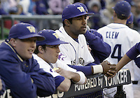 03 April 2009:  Washington's #21 Caleb Brown (right) watches with teammates along the top stair of the dug out before the game against Arizona State at Safeco Field in Seattle, WA.  Arizona State won 3-1 over Washington.