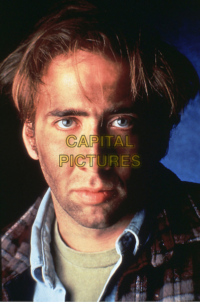 NICOLAS CAGE.in Amos & Andrew (1993) .*Filmstill - Editorial Use Only*.CAP/STF/KHE.Supplied by Capital Pictures.
