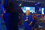 Hempstead, New York, USA. May 23, 2018. MARCIA KRAMER, WLNY 10/55 Political Reporter, tapes news segment with audience and stage in background during Day 1 of New York State Democratic Convention, held at Hofstra University on Long Island.
