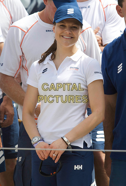 CROWN PRINCESS VICTORIA OF SWEDEN.On board the sail boat Ericsson 4 during the Volvo Ocean Race 2008 - 2009, Marina Gloria, Rio de Janeiro, Brazil, April 3rd 2009..swedish royal family half length blue cap hat white t-shirt .CAP/PPG/JH.©Jens Hartmann/People Picture/Capital Pictures