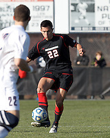 Northeastern University defender Mike Lobben (22) passes the ball. .NCAA Tournament. University of Connecticut (white) defeated Northeastern University (black), 1-0, at Morrone Stadium at University of Connecticut on November 18, 2012.