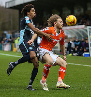 Sido Jombati of Wycombe Wanderers and Craig Mackail-Smith of Luton Town during the Sky Bet League 2 match between Wycombe Wanderers and Luton Town at Adams Park, High Wycombe, England on 6 February 2016. Photo by David Horn.