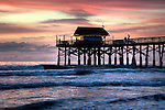 A Sunrise View of the Cocoa Beach Pier in Florida - Fishermen in the early morning