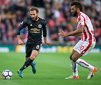 Juan Mata of Man Utd & Eric Maxim Choupo-Moting of Stoke City during the Premier League match between Stoke City and Manchester United at the Britannia Stadium, Stoke-on-Trent, England on 9 September 2017. Photo by Andy Rowland.