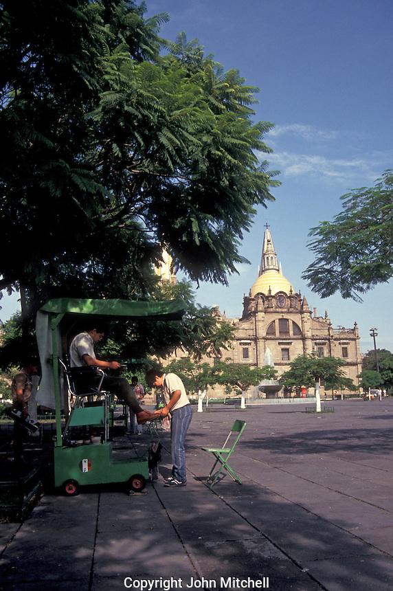 Man getting a sheshine in the Plaza de la Liberacion, Guadalajara, Mexico