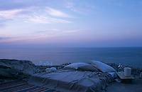 A simple mattress on the terrace has a romantic view over the Aegean