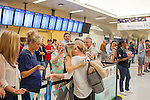 Friends and family greet Holly Houston, who just arrived on a flight from Australia, at the arrivals lobby at Hartsfield–Jackson Atlanta International Airport, in Atlanta, Georgia on August 28, 2013.