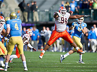 SAN FRANCISCO, CA - December 31, 2011: Illinois defensive tackle Akeem Spence (94) attempts to block a pass against UCLA at AT&T Park in San Francisco, California. Final score Illinois wins 20-14.