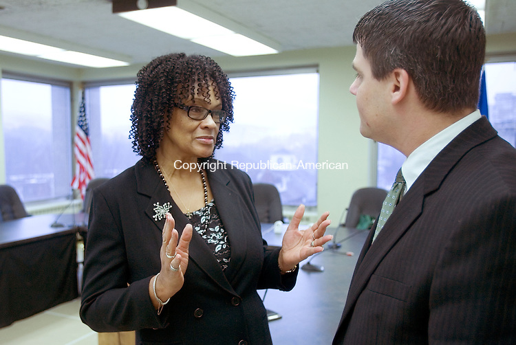 NAUGATUCK, CT. 28 February 2011-022811SV04--Jessie O. Ballenger who was named African-American Mayor of the day talks with Mayor Robert A. Mezzo during a ceremony at town hall in Naugatuck Monday.<br /> Steven Valenti Republican-American