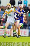 Ray Galvin Lixnaw in action against Tommy Maunsell Kilmoyley in the County Senior Hurling final at Austin Stack Park on Saturday.