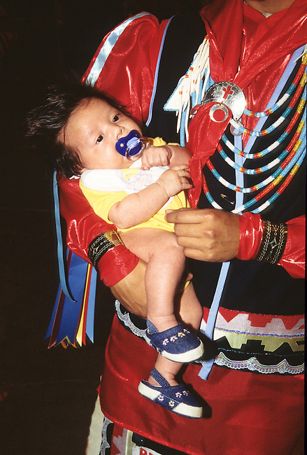 Youngest participant who is an infant girl, just days old, attends the Red Earth Indian Festival in Oklahoma City, OK.