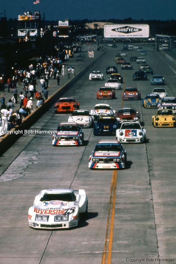 John Greenwood's Corvette leads at the start of the 1975 IMSA race at Sebring International Raceway near Sebring, Florida.