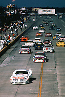 John Greenwood's Corvette leads at the start of the 1975 IMSA race at Sebring International Raceway near Sebring, Florida.
