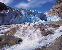A vigourous melt-water stream issuing from the snout of the Nigardsbreen glacier, Jostedal National Park, Norwa