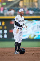 Yoan Moncada (10) of the Charlotte Knights takes off his batting gloves after being stranded on second base during the game against the Durham Bulls at BB&T BallPark on May 15, 2017 in Charlotte, North Carolina. The Knights defeated the Bulls 6-4.  (Brian Westerholt/Four Seam Images)