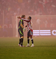 Chivas USA goal keeper Brad Guzan (18) and forward Maykel Galindo (11) discuss strategy during a break from the red smoke bomb that the Chivas fans threw out onto the field late in the second half. CD Chivas USA defeated the LA Galaxy in the Super Clasico 3-0 at the Home Depot Center in Carson, CA, Thursday, September 13, 2007.