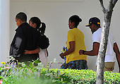 United States President Barack Obama and his family walk on the Colonnade of the White House after their return to the South Lawn in Washington, D.C. from a weekend at Camp David, the presidential retreat near Thurmont, Maryland.  From left to right: President Obama, Malia Obama, first lady Michelle Obama, and Avery Robinson (the Obamas' nephew)..Credit: Ron Sachs / Pool via CNP