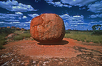 Devils Marbles located near Wauchope, approximately 114&100bsp;km south of Tennant Creek, in the Northern Territory. The site is known as Karlu Karlu to the land's Aboriginal traditional owners. The 'Devils Marbles' or 'Karlu Karlu' with its gigantic, rounded granite boulders, some spectacularly poised, is a remarkable landscape. Scattered clusters of these 'marbles', including many balancing rocks, are spread across a wide, shallow valley. The Devils Marbles is a nationally and internationally recognised symbol of Australia's outback.