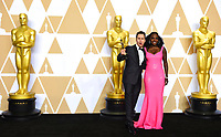 """Sam Rockwell, winner of the award for best performance by an actor in a supporting role for """"Three Billboards Outside Ebbing, Missouri"""", and Viola Davis, right, pose in the press room at the Oscars on Sunday, March 4, 2018, at the Dolby Theatre in Los Angeles. (Photo by Jordan Strauss/Invision/AP)"""