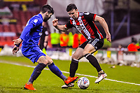 Sheffield United's defender Enda Stevens (3)  turnsCardiff City's midfielder Callum Paterson (18) during the Sky Bet Championship match between Sheff United and Cardiff City at Bramall Lane, Sheffield, England on 2 April 2018. Photo by Stephen Buckley / PRiME Media Images.
