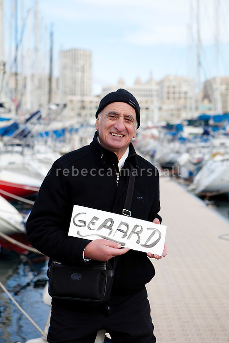 Gerard, a volunteer guide with the Marseille Provence Greeters, poses for the photographer in the Old Port, Marseille, France, 04 February 2013