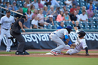 Danny Mendick (17) of the Charlotte Knights is tagged out by Buffalo Bisons third baseman Alen Hanson (31) as umpire Adam Beck looks on at BB&T BallPark on July 24, 2019 in Charlotte, North Carolina. The Bisons defeated the Knights 8-4. (Brian Westerholt/Four Seam Images)