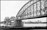 BNPS.co.uk (01202 558833)<br /> Pic: Fellows/BNPS<br /> <br /> Sgt Rowson's photograph of the rail bridge over the Waal at Nijmegen.<br /> <br /> Resurfacing - Historic watch captured from a brave German frogman, for whom the road bridge at Nijmegen proved a bridge to far.<br /> <br /> The family of a British WW2 hero who captured a German diver trying to blow up a vital bridge in the wake of Operation Market Garden, are now <br /> selling the incredibly rare Rolex Panerai watch seized from the exhausted diver.<br /> <br /> Sergeant Major George Rowson helped thwart the attempt to destroy the recently captured road bridge at Nijmegen after another team of German frogman had managed to destroy the neighbouring rail bridge.<br /> <br /> The highly trained German special forces placed fixed charges to the underwater footings of both bridge's, but after being spotted, under heavy fire, and in an exhausted state they were captured at gunpoint by Sgt Rowson and his colleagues. <br /> <br /> Sgt Rowson relieved the frogman of his precious watch and wetsuit and kept them until his recent death.<br /> <br /> His family are now selling the historic artefacts with specialist Auctioneers Fellows in Birmingham, with a whopping &pound;40,000 estimate.