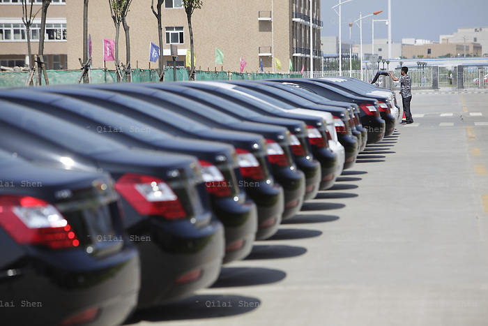 Cars pack in the parking lot of the Geely Automobile Holdings Ltd. factory in Cixi, Zhejiang Province, China, on 21 June, 2012. Geely Automobile Holdings aims to become China's largest auto exporter in two years focusing on developing economy such as Africa and South America.