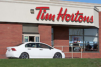 A car is seen at a Tim Hortons drive-thru in Quebec city Wednesday October 19, 2011. Tim Hortons Inc. (TSX: THI, NYSE: THI) is a Canadian fast casual restaurant known for its coffee and doughnuts.