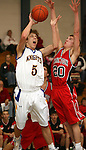 SIOUX FALLS, SD - JANUARY 28:  Alex Robey #5 of O'Gorman tries t o get a shot off past Nate Lien #20 of Yankton in the first half of their game Thursday night at O'Gorman. (Photo by Dave Eggen/Inertia)