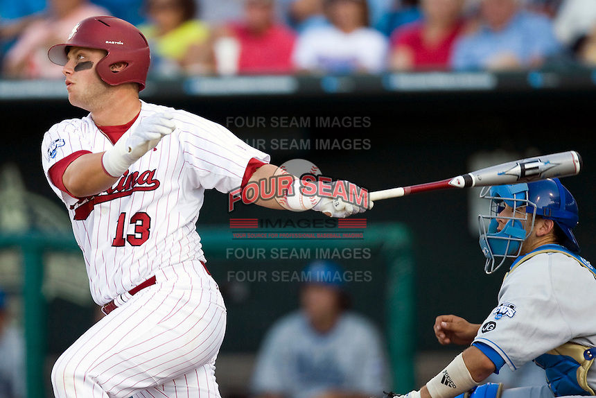 South Carolina 1B Christian Walker follows thru on his swing during Game Two of the NCAA Division One Men's College World Series Finals on June 29th, 2010 at Johnny Rosenblatt Stadium in Omaha, Nebraska.  (Photo by Andrew Woolley / Four Seam Images)