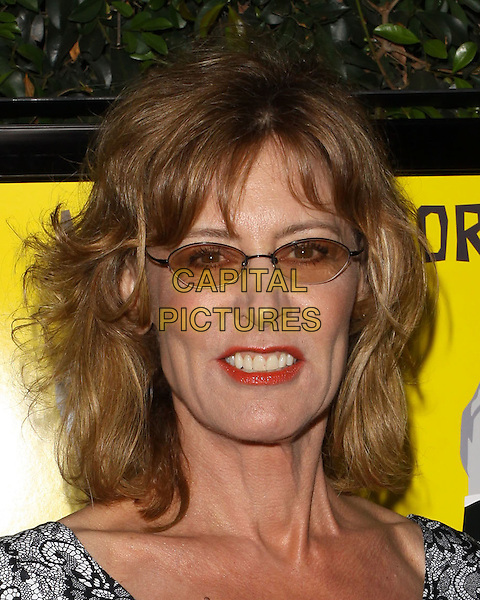 "CHRISTINE LAHTI.""Capitalism: A Love Story"" Los Angeles Premiere held At AMPAS Samuel Goldwyn Theater, Beverly Hills, California, USA..September 15th, 2009.headshot portrait tinted red lipstick glasses teeth .CAP/ADM/KB.©Kevan Brooks/AdMedia/Capital Pictures."