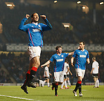 Bilel Mohsni celebrates after scoring the second goal for Rangers