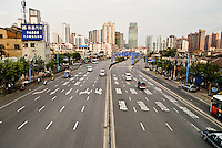 View of road and city skyline, Shanghai, China