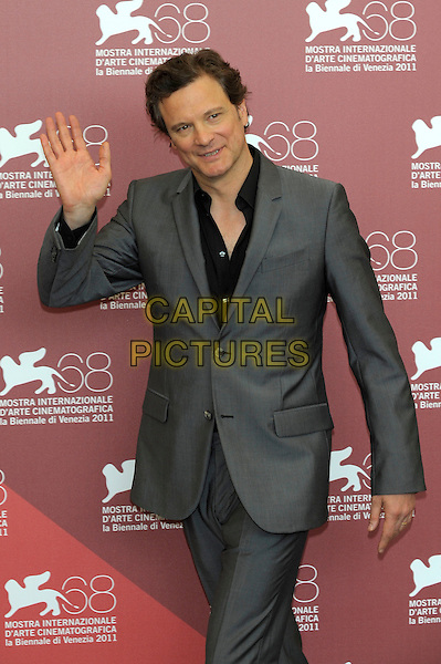 Colin Firth.'Tinker, Tailor, Soldier, Spy' photocall  86th Venice Film Festival, Italy 5th September 2011.half length suit hand palm waving shirt grey gray black.CAP/PL.©Phil Loftus/Capital Pictures.