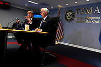 President Donald Trump listens as Vice President Mike Pence speaks during a teleconference with governors at the Federal Emergency Management Agency headquarters, Thursday, March 19, 2020, in Washington. (AP Photo/Evan Vucci, Pool)<br /> Credit: Evan Vucci / Pool via CNP/AdMedia