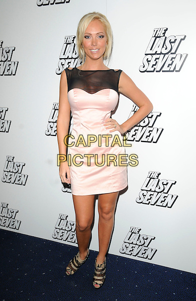 "AISLEYNE HORGAN-WALLACE.At ""The Last Seven"" UK Film Premiere, Odeon cinema Covent Garden, London, England, UK, August 24th 2010..full length black mesh dress pink nude hand on hip sleeveless snakeskin print animal snake peep toe ankle boots booties shoes shooboots .CAP/CAN.©Can Nguyen/Capital Pictures."