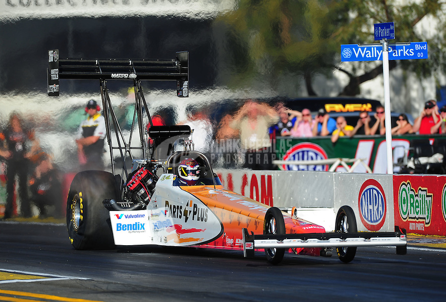 Feb. 9, 2012; Pomona, CA, USA; NHRA top fuel dragster driver Clay Millican during qualifying at the Winternationals at Auto Club Raceway at Pomona. Mandatory Credit: Mark J. Rebilas-