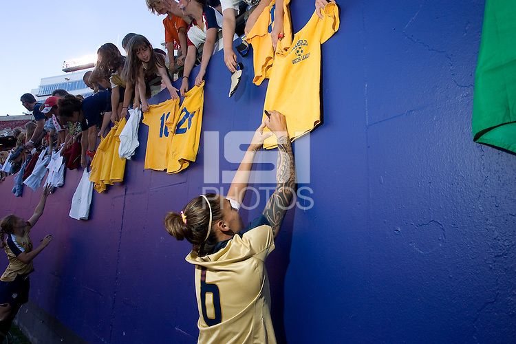 Natasha Kai signs a fan t-shirt. USA defeated Brazil 2-0 at Giants Stadium on Sunday, June 23, 2007.