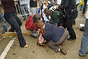 New Orleans police officers pepper spray and taser protesters at the New Orleans City Council meeting where the council is expected to vote for the demolition of housing projects in the city, New Orleans, Thursday, Dec. 20, 2007..(AP Photo/Cheryl Gerber)