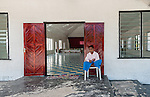 A young boy waits for Sunday Service at the entrance to a local church in Kiritimati in Kiribati.