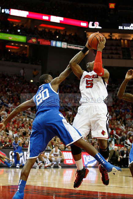 Doron Lamb blocking a shot by Chris Smith at the Yum! Center on Friday, December 31, 2010. Photo by Latara Appleby | Staff