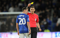 Referee Matt Donohue shows Cardiff City's Gavin Whyte the yellow card<br /> <br /> Photographer Ian Cook/CameraSport<br /> <br /> The EFL Sky Bet Championship - Cardiff City v Queens Park Rangers - Wednesday 2nd October 2019  - Cardiff City Stadium - Cardiff<br /> <br /> World Copyright © 2019 CameraSport. All rights reserved. 43 Linden Ave. Countesthorpe. Leicester. England. LE8 5PG - Tel: +44 (0) 116 277 4147 - admin@camerasport.com - www.camerasport.com