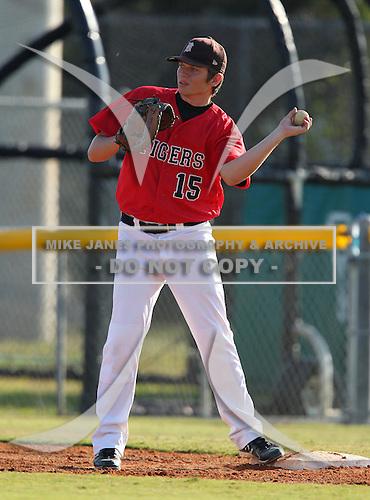 Gavin McArdle of the Dunnellon Tigers varsity baseball team against the Bishop Verot Vikings during the Sarasota Classic on March 14, 2011 in Sarasota, Florida.  (Copyright Mike Janes Photography)