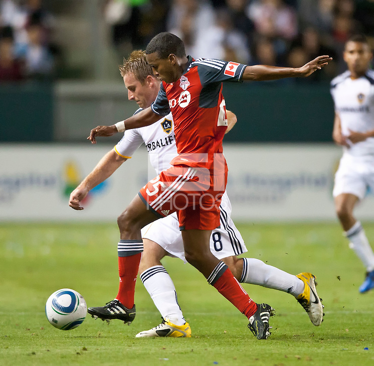 CARSON, CA – June 11, 2011: LA Galaxy midfielder Chris Birchall (8) and Toronto FC defender Danleigh Borman (25) during the match between LA Galaxy and Toronto FC at the Home Depot Center in Carson, California. Final score LA Galaxy 2, Toronto FC 2.